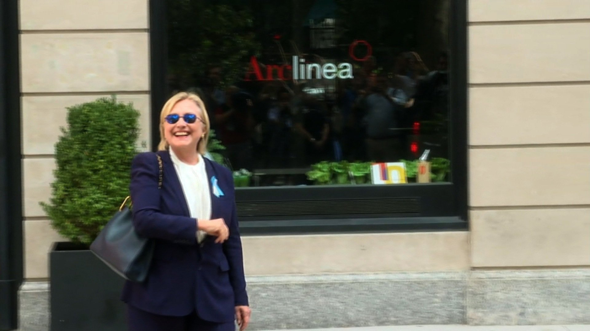 Clinton at home after leaving 9/11 event early
