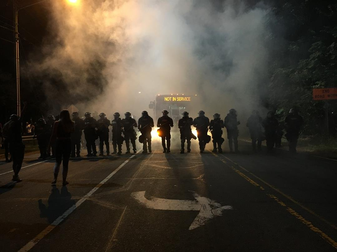 Police try to quell anger after shooting triggers unrest