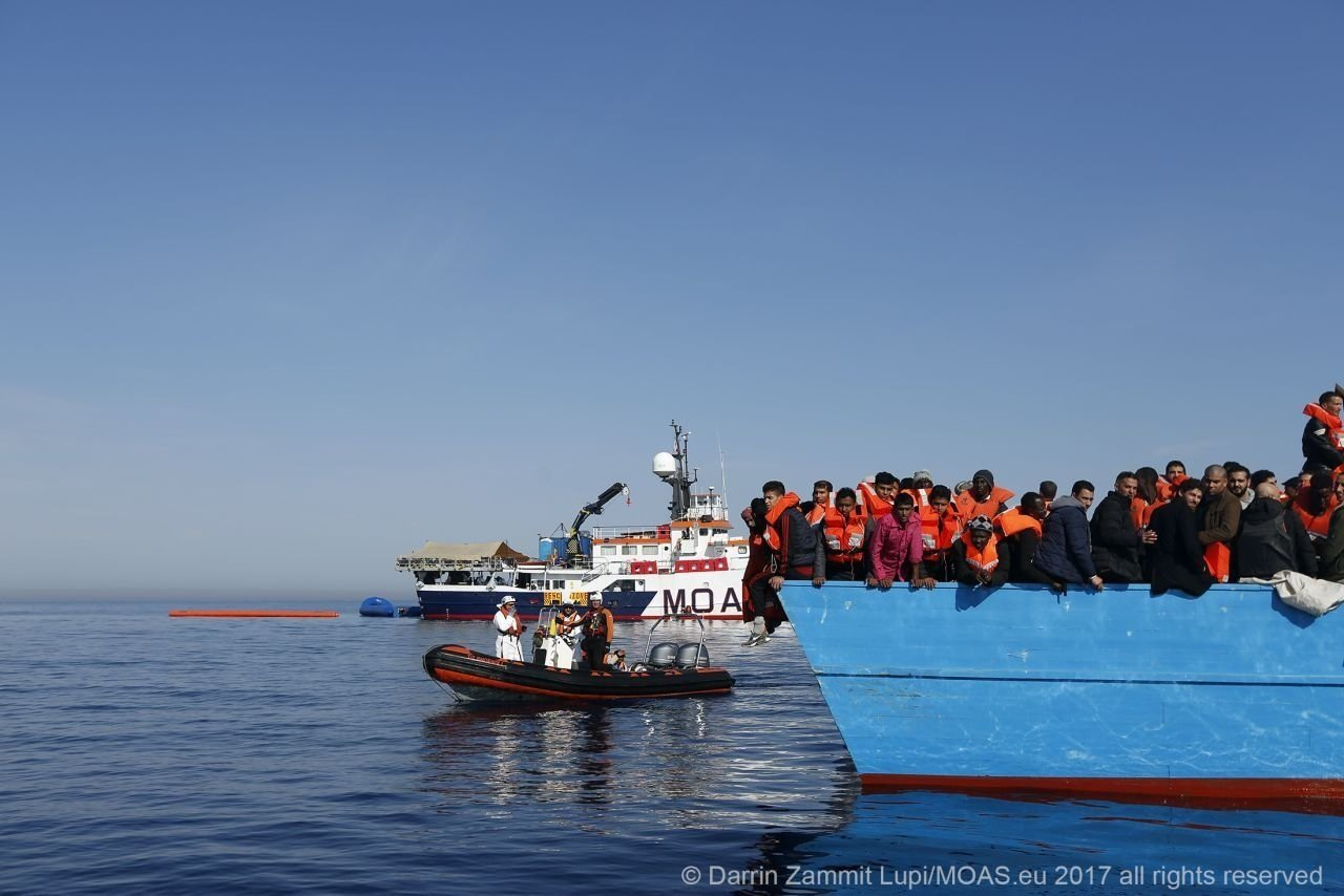 Nearly 100 migrants feared missing after boat sinks off Libya
