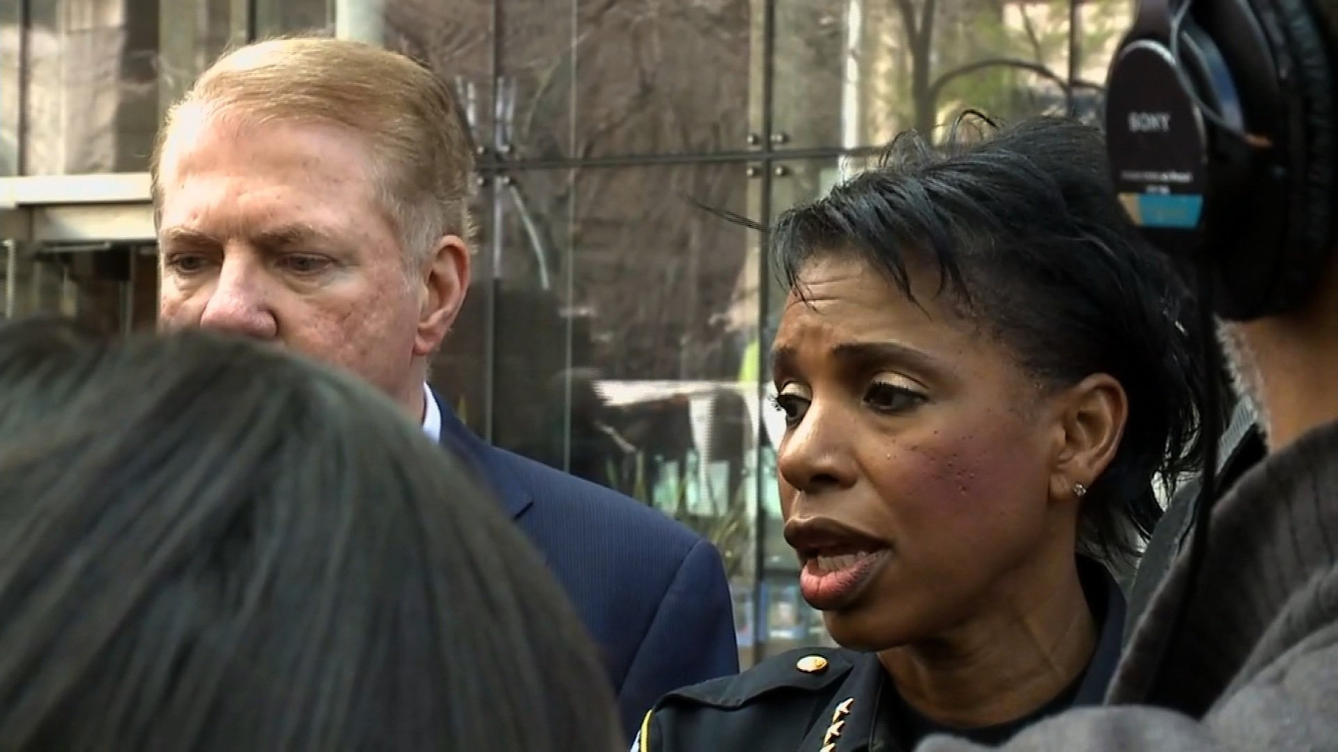 **Embargo: Seattle, WA**  As officers responded, a female suspect hit one of the officers on the head with a bottle and another suspect ran into a building, barricading himself inside, Seattle Police spokeswoman Carmen Best said at a news conference.