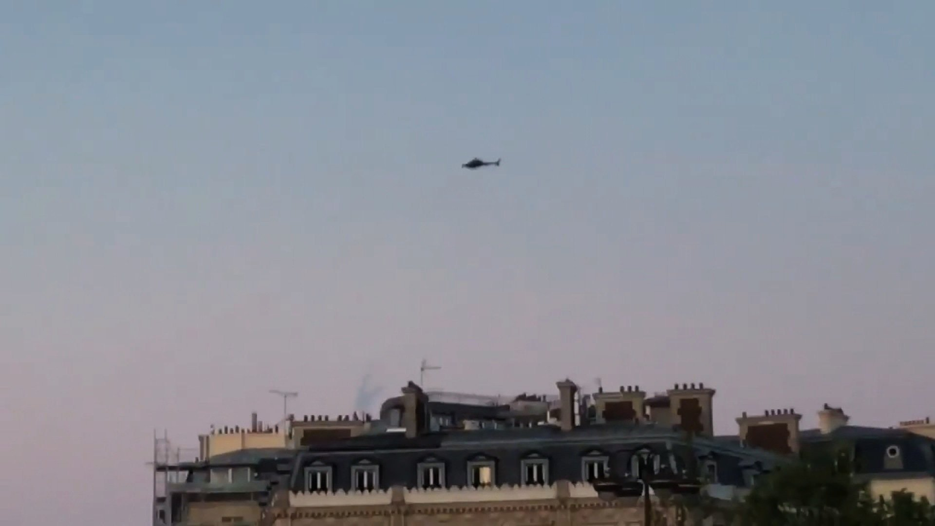 A helicopter can be seen above the Champs-Elysées area in Paris, France, after gunshots were reported on April 20, 2017.