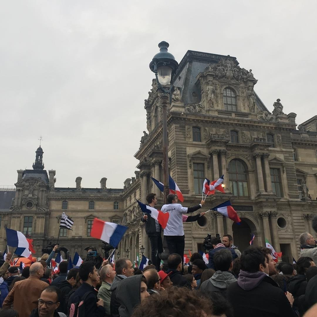 Supporters of French presidential candidate Emmanuel Macron celebrate his victory on Sunday outside The Louvre in Paris France