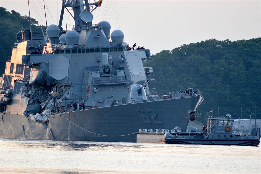 The damaged USS Fitzgerald returns to port in Yokosuka following a collision with a merchant vessel.