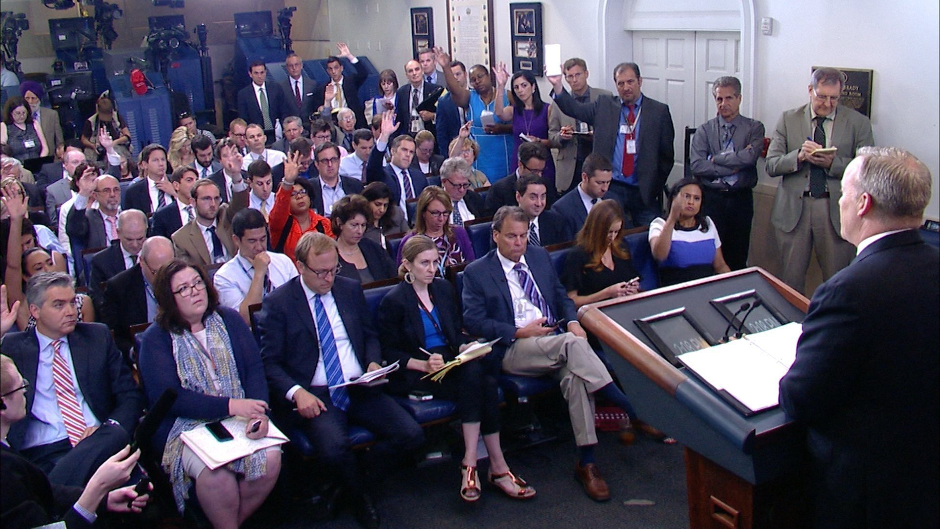 Sean Spicer angrily confronted by CNN reporter during tense off-camera press briefing