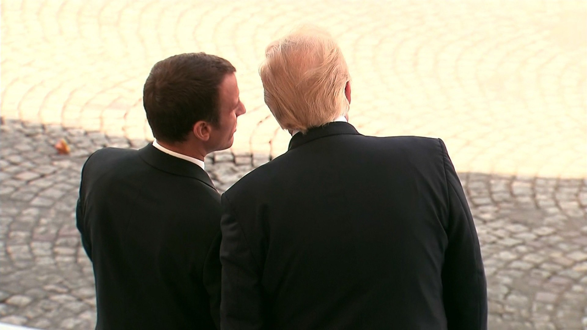 Trump defends son in Paris press conference