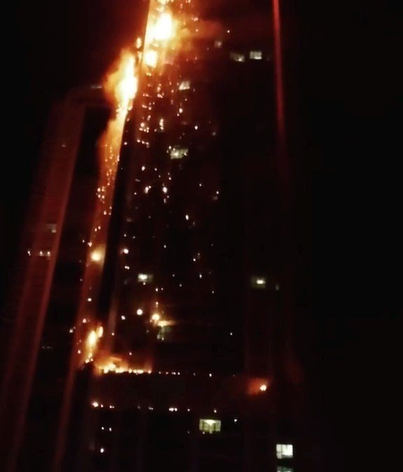 Firefighters battle a blaze at the 79-story Torch tower near Dubai Marina the Dubai Media Office said early Friday