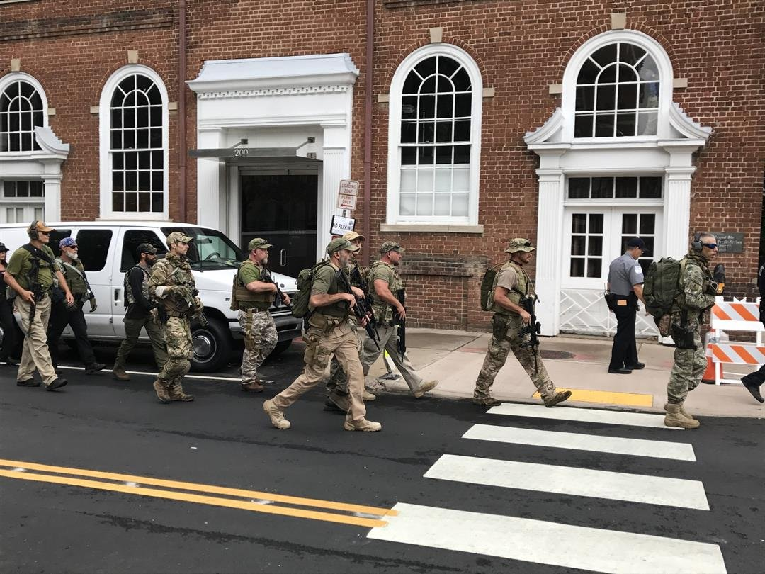 Several members of an alt right group have gathered in Charlottesville, Va to express their first amendment rights. In the photos, you can see a group people carrying long guns as they walk through the streets of Virginia.