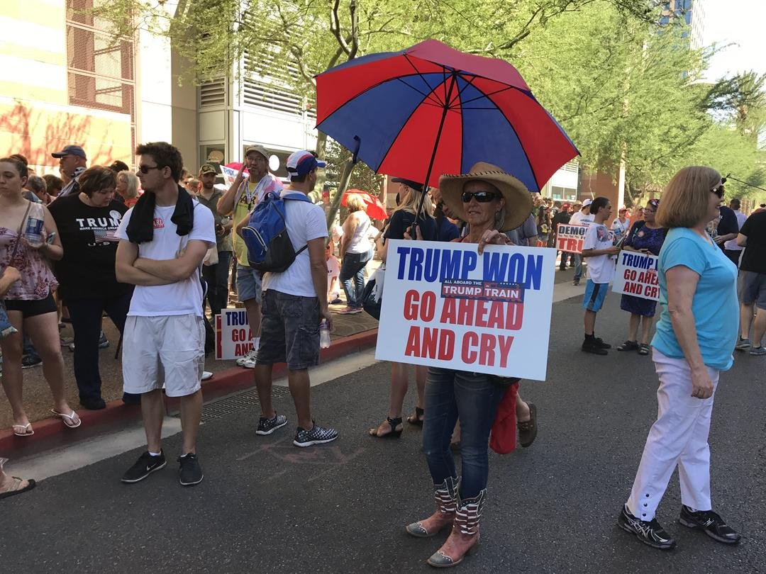 Trump supporters and protesters are seen here ahead of President Trump's rally at the Phoenix Convention Center