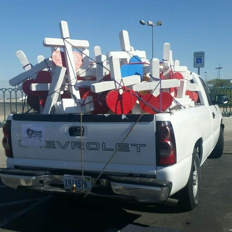 Crosses with hearts on them were made and driven to Las Vegas from Illinois by Greg Zanis of Aurora, Illinois.