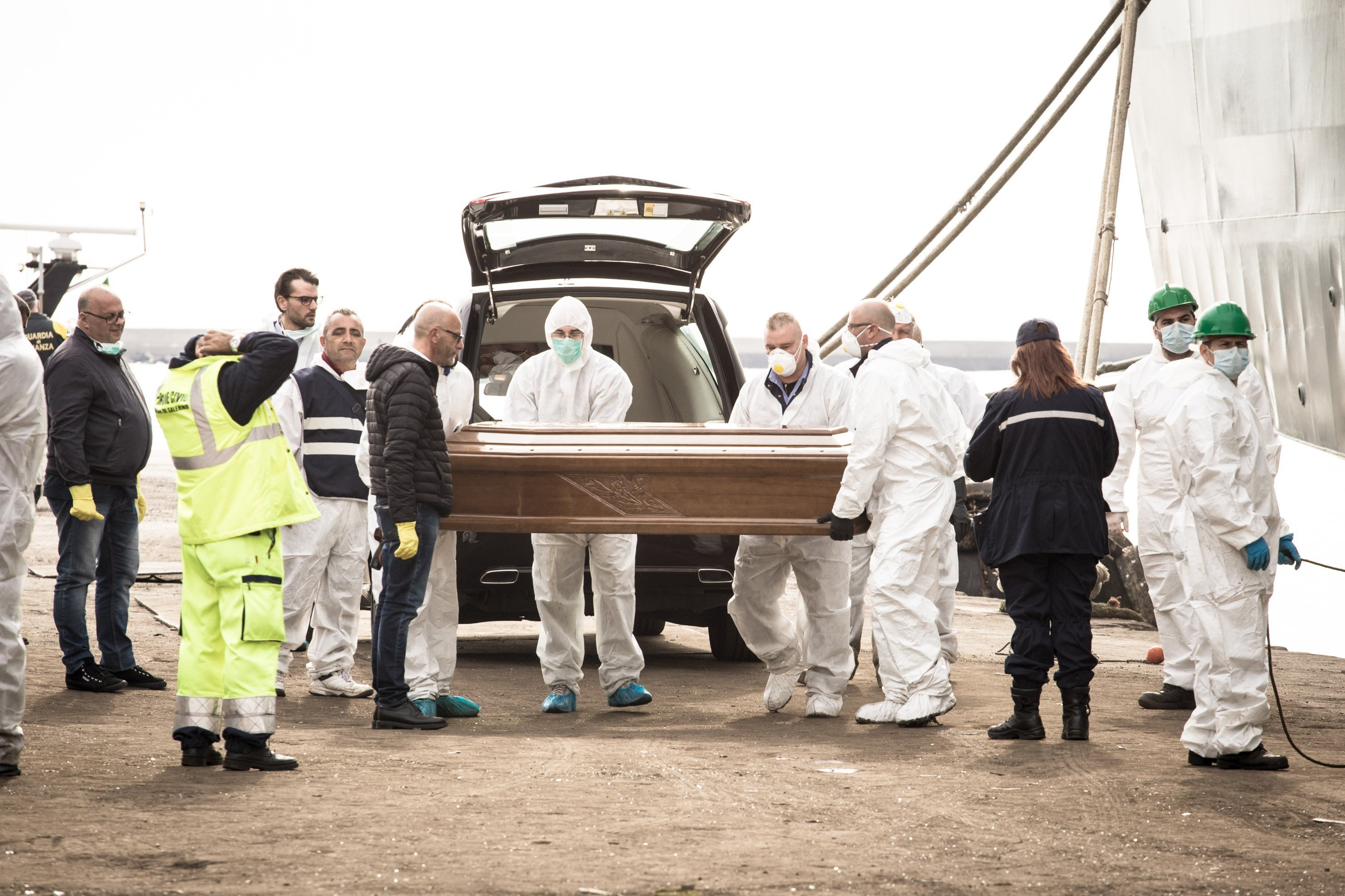 **This image is for use with this specific article only**  The bodies of 26 young migrants arrive at the Italian port town of Salerno on Sunday.