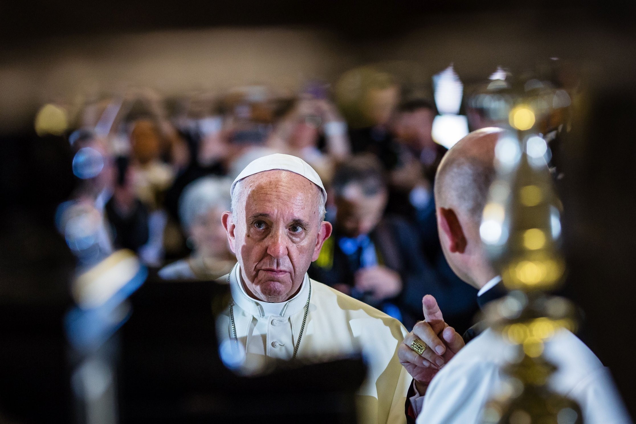 **This image is for use with this specific article only**  Pope Francis wants you to do him a favor. The next time you're in Mass -- put down your cell phone.