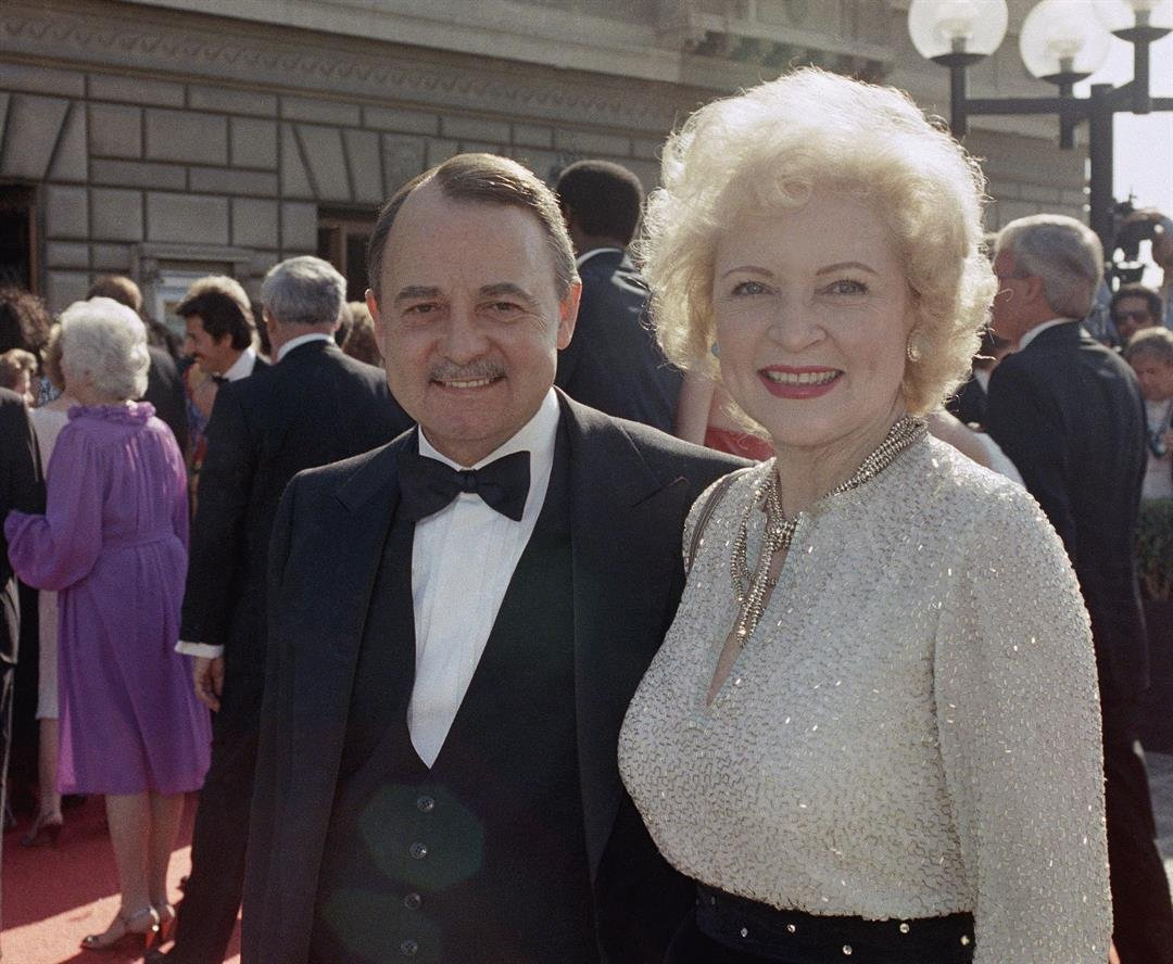 John Hillerman, left, and Betty White, right, arriving at Emmy Awards in Pasadena, California in 1985.  ***This image is for use with this specific article only.***