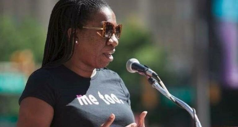 Tarana Burke, wearing a 'me too' T-shirt, addresses the March to End Rape Culture in Philadelphia in 2014.