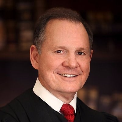 Roy Moore has appeared multiple times on a radio show hosted by a controversial pastor who preaches that the biblical punishment for homosexuality is death.