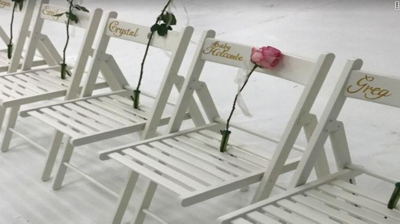 A single pink rose was placed on a chair in honor of the unborn child. Crystal Holcombe, who was two months pregnant, was killed in the attack.
