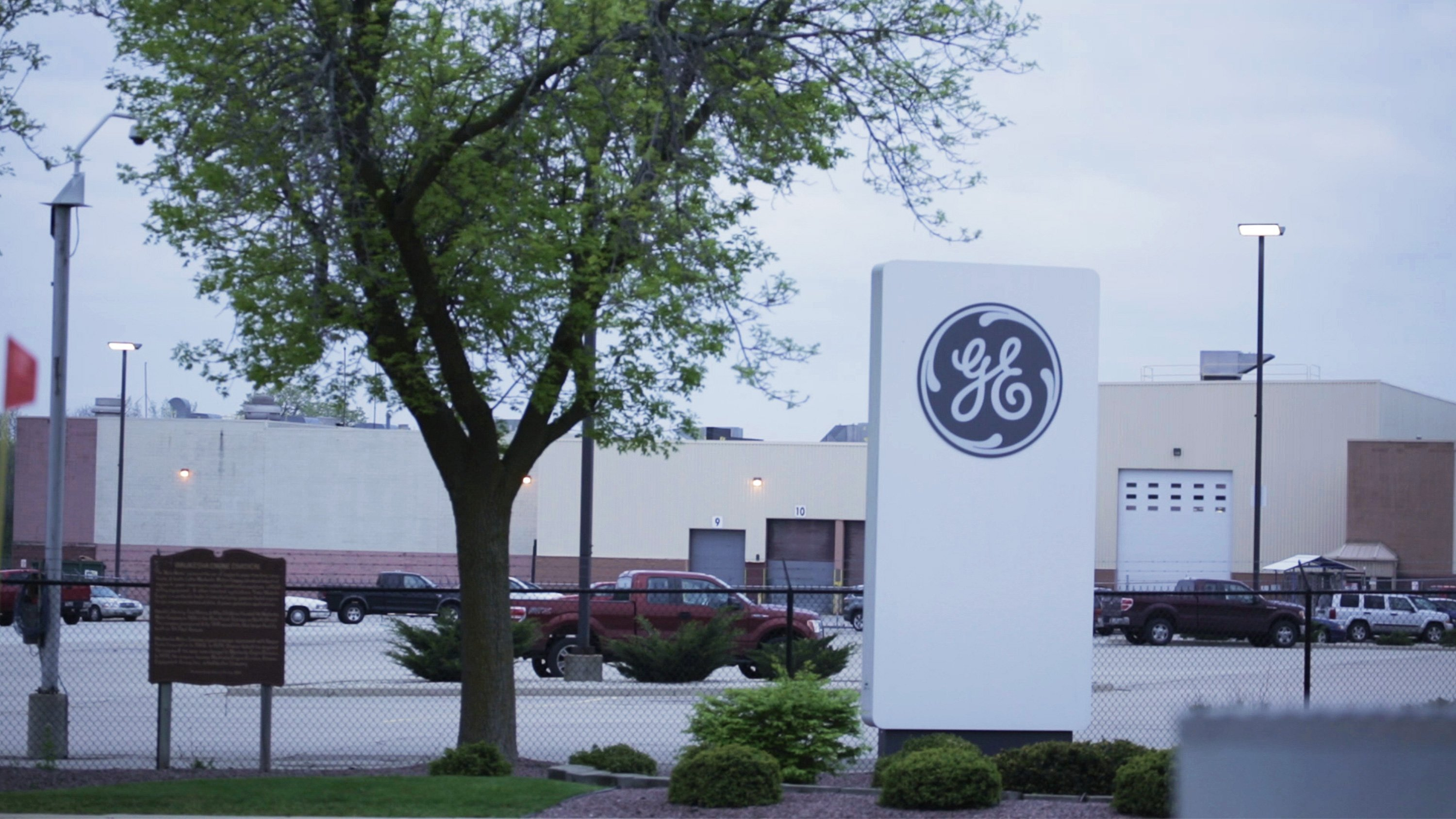 General Electric is slashing its coveted stock dividend in half and getting even smaller by selling storied businesses such as its railroad and light bulb units.