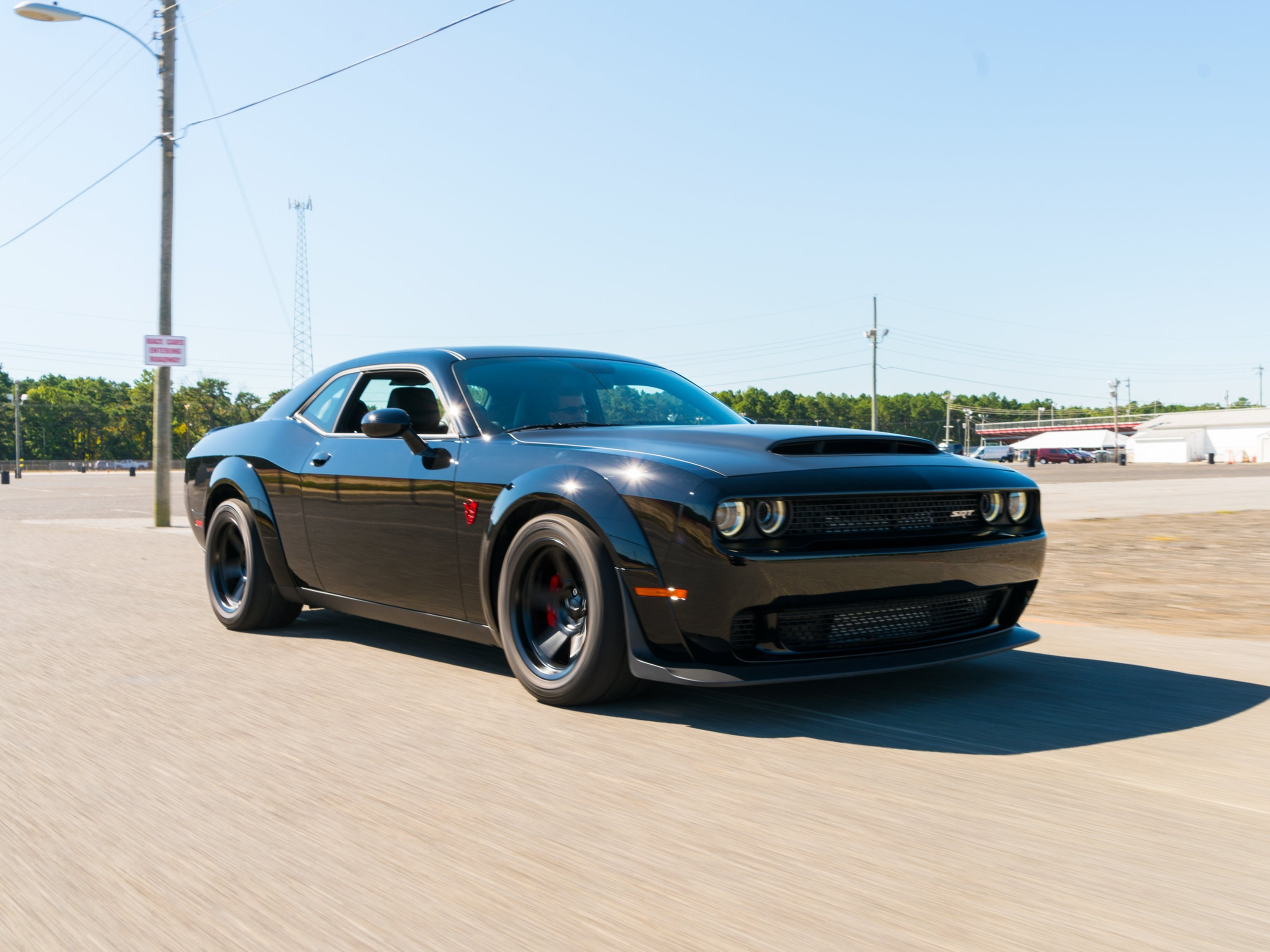 It's an 840 horsepower Dodge Challenger muscle car that has been engineered specifically to do two things: Run the quarter mile in under 10 seconds and lift its front wheels off the ground during a hard launch.