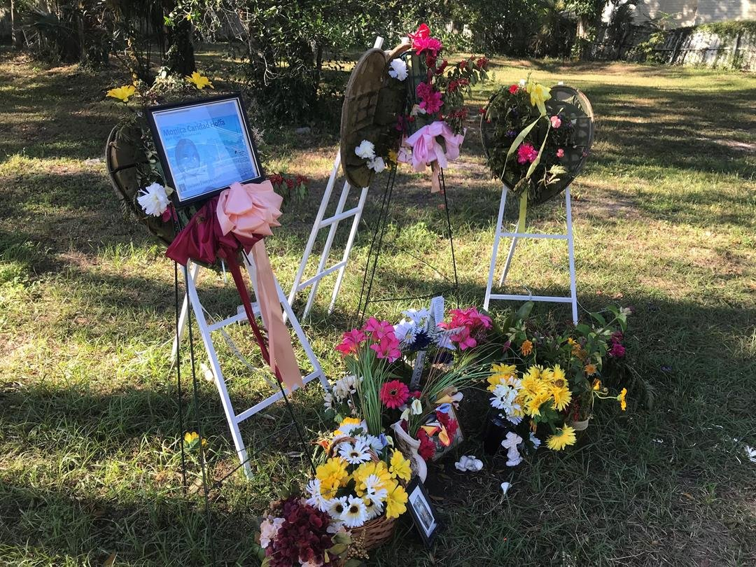 A memorial is set up where victim Monica Caridad's body was found in Seminole Heights, Florida.