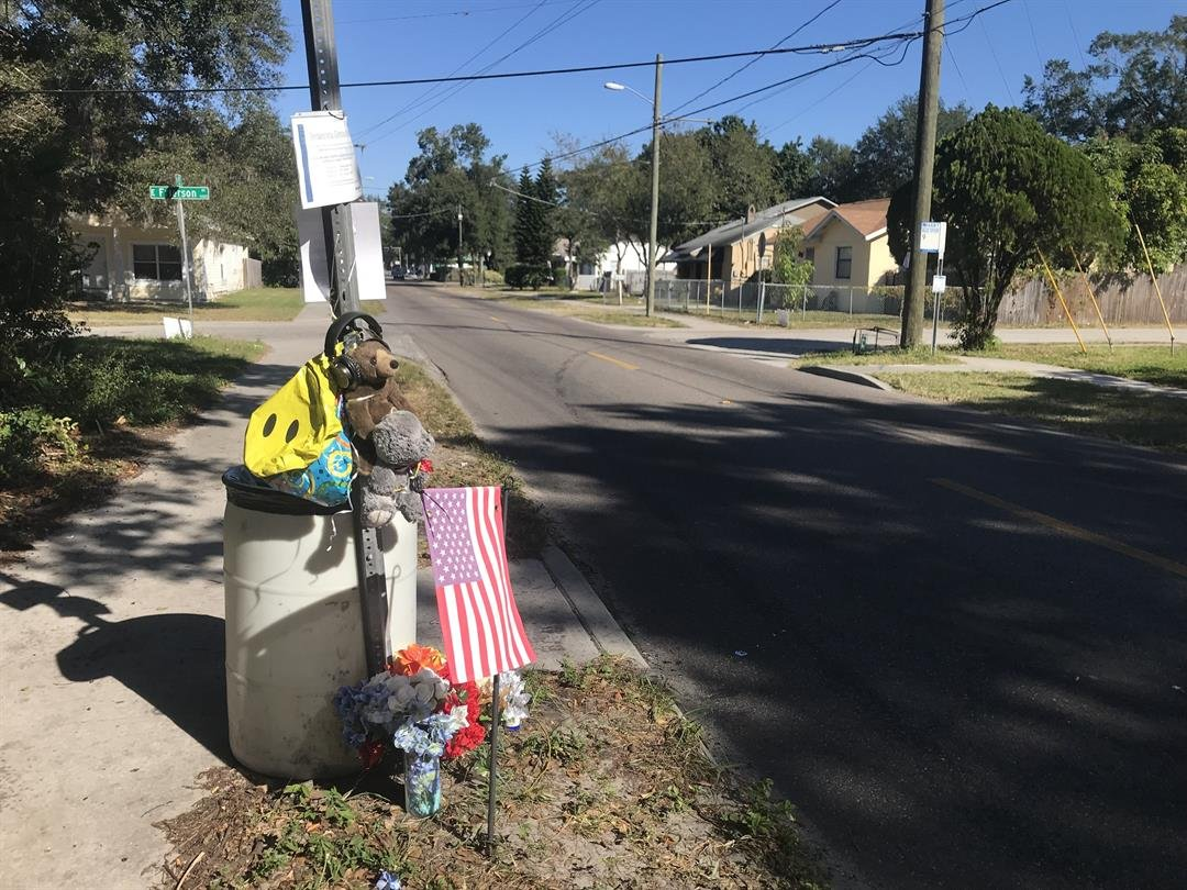 A memorial is set up at the bus stop on 15th and Frierson in Seminole Heights, Florida.