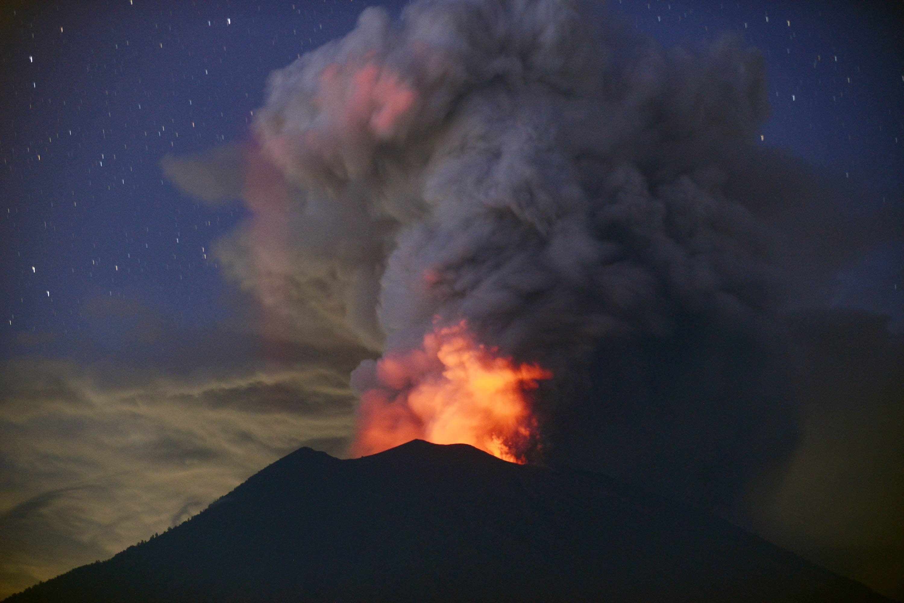 **This image is for use with this specific article only**  Bali's main airport re-opened on Wednesday after being shuttered for nearly three days due to a volcanic eruption which blanketed parts of the island in ash, forcing thousands of evacuations.