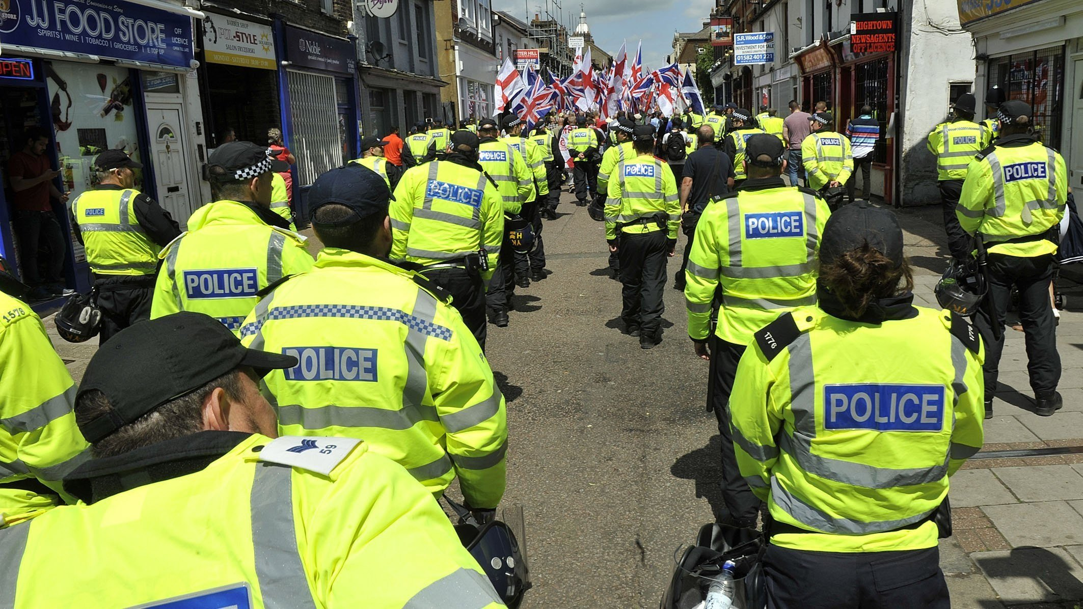 **This image is for use with this specific article only**  Police officers monitor a Britain First protest march in Luton, England, in June 2015.  CREDIT: Tony Margiocchi/Barcroft Media/Getty Images