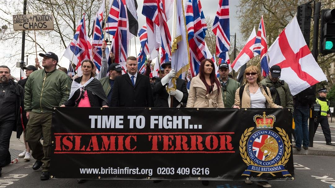 **This image is for use with this specific article only**  Leaders of Britain First Jayda Fransen, second from right, and Paul Golding, third from left, lead a march in London on April 1, 2017.  CREDIT: Wiktor Szymanowicz/Barcroft Media/Getty Images