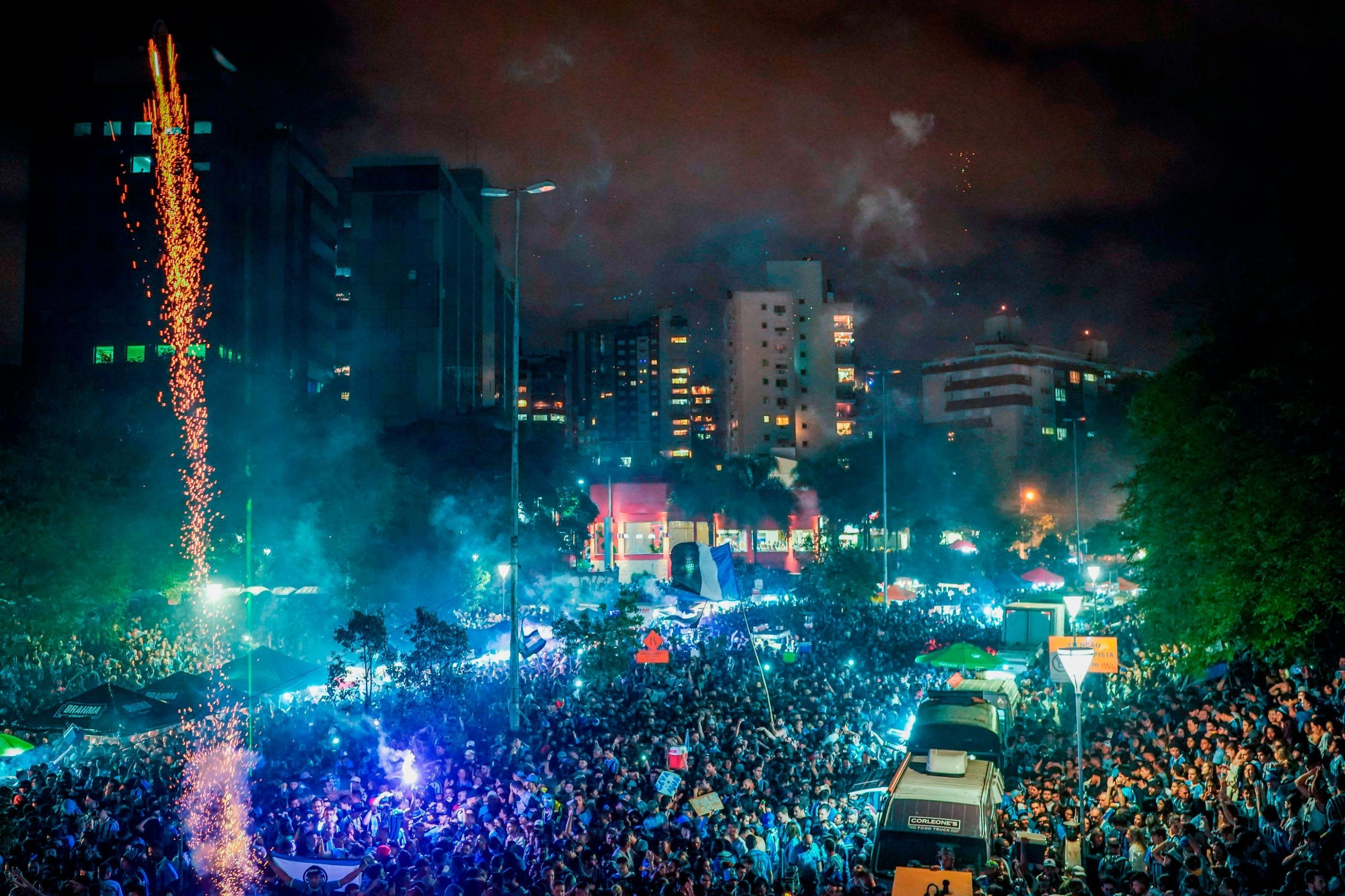 **This image is for use with this specific article only.**  Thousands of Gremio fans line the streets of Porto Alegre to celebrate their team's Copa Libertadores win.  Credit: Jefferson Bernardes/AFP/Getty Images