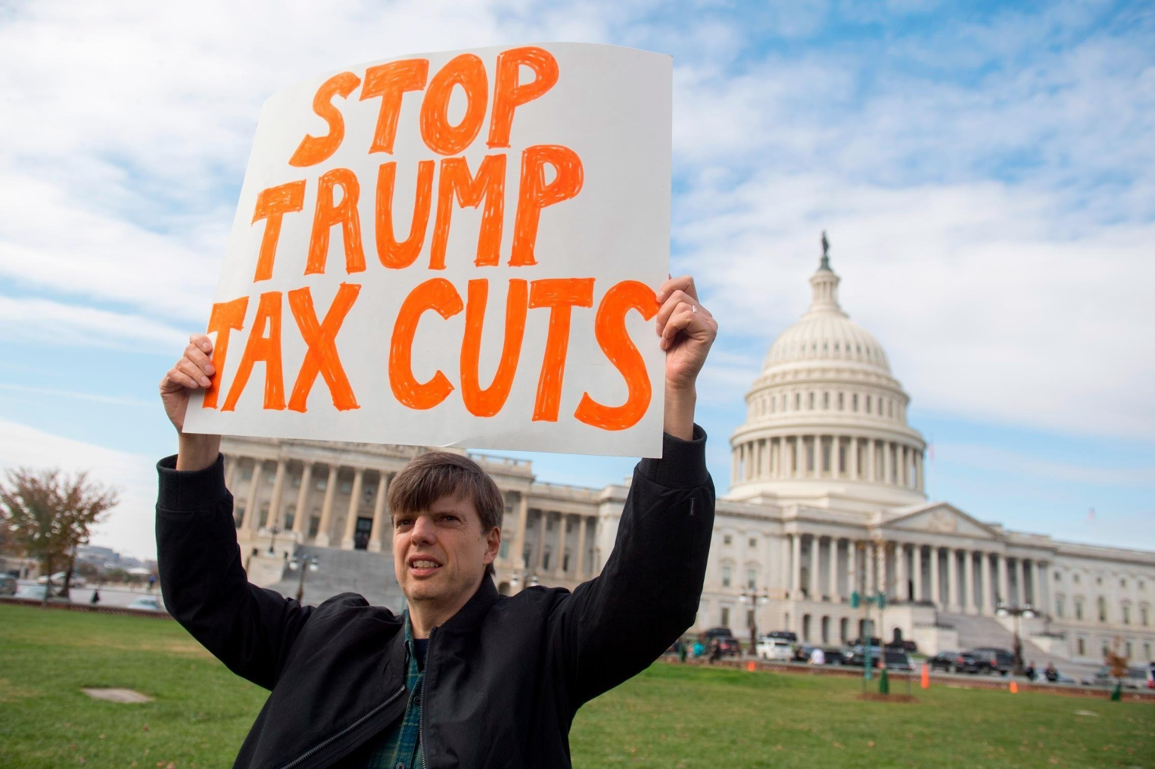 This image is for use with this specific article only.** Demonstrators protest against the Republican tax reform plan during a rally organized by Our Revolution and Americans for Tax Fairness Action Fund on Capitol Hill in Washington DC November