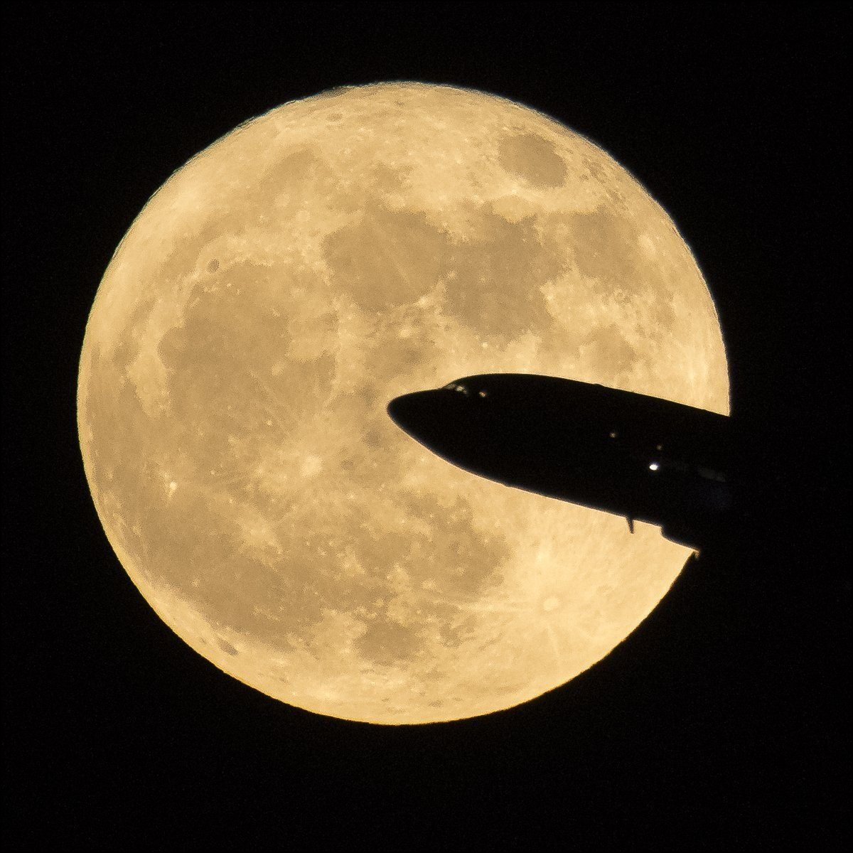 An aircraft taking off from Ronald Reagan National Airport is seen passing in front of the Moon as it rises Sunday Dec. 3 2017 in Washington D.C