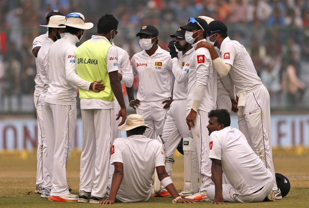 **This image is for use with this specific article only.**  Sri Lanka's cricket team wears anti-pollution masks as they play the second day of their third test match in New Delhi, on Sunday December 3.
