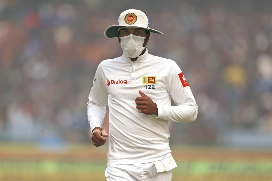 **This image is for use with this specific article only.**  Captain of Sri Lanka's cricket team, Dinesh Chandimal wears an anti-pollution mask during the cricket match in New Delhi on Sunday, December 3.