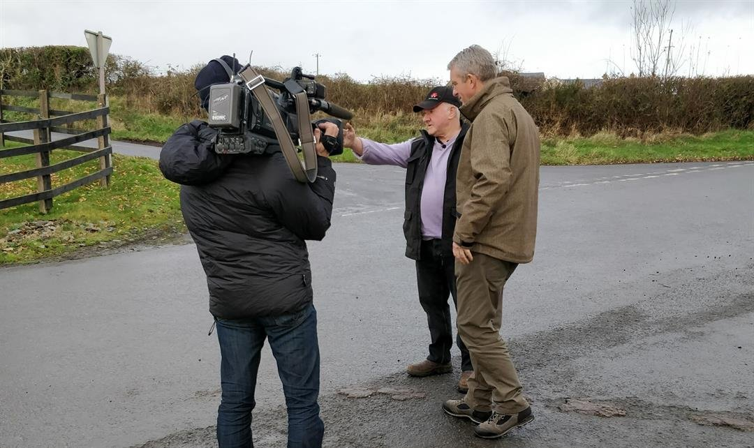 Farmer Francie Ward shows CNN's Nic Robertson the Irish border along his road.
