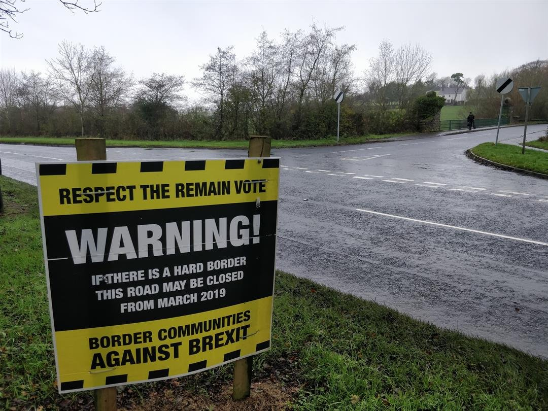 A sign on the Irish border warns of a hard border after Brexit.