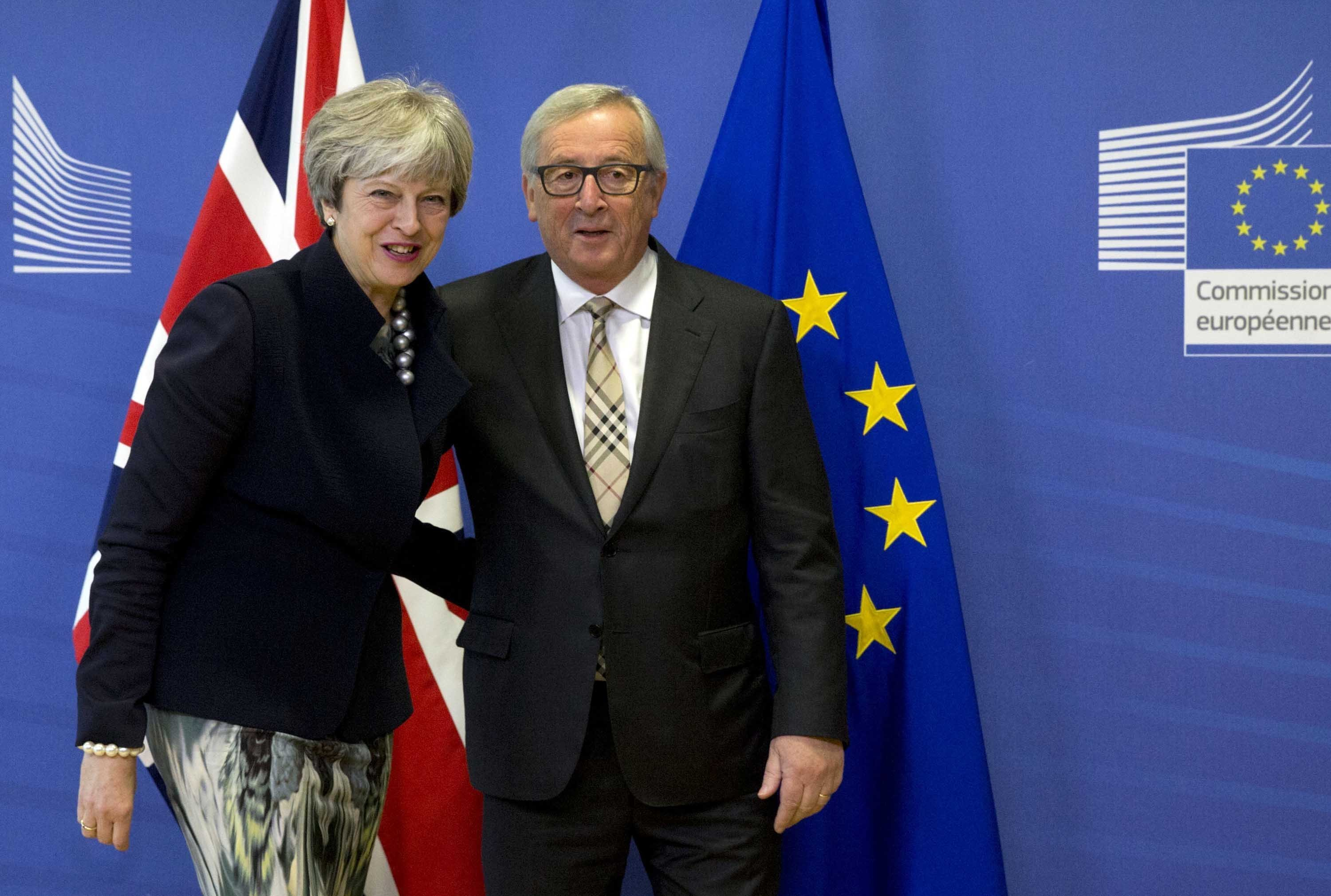 **This image is for use with this specific article only.**  European Commission President Jean-Claude Juncker greets British PM Theresa May prior to a crucial Brexit meeting at EU headquarters in Brussels on Monday, December 4, 2017.