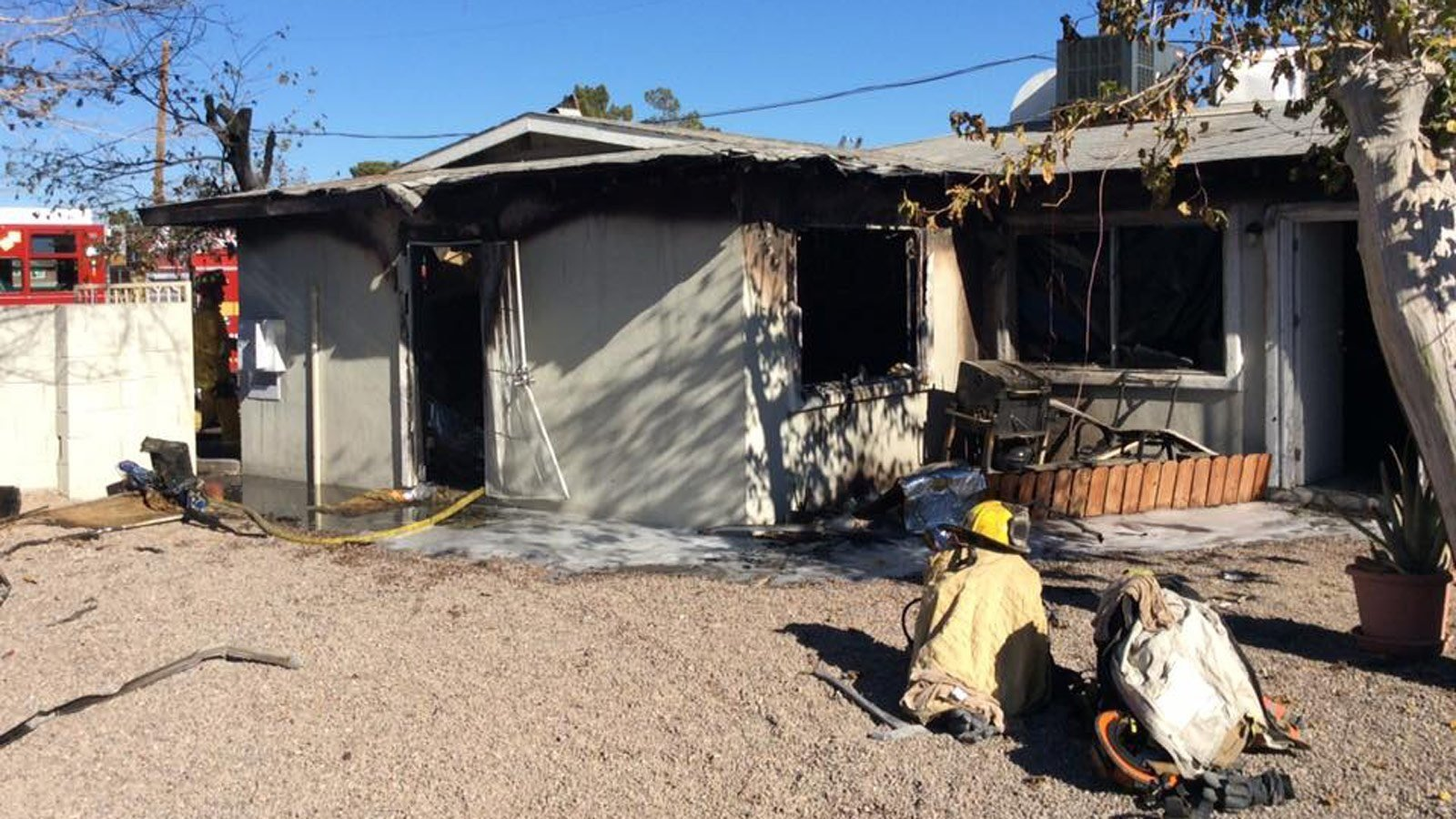 A homeless man saved two children from their burning home, officials say.