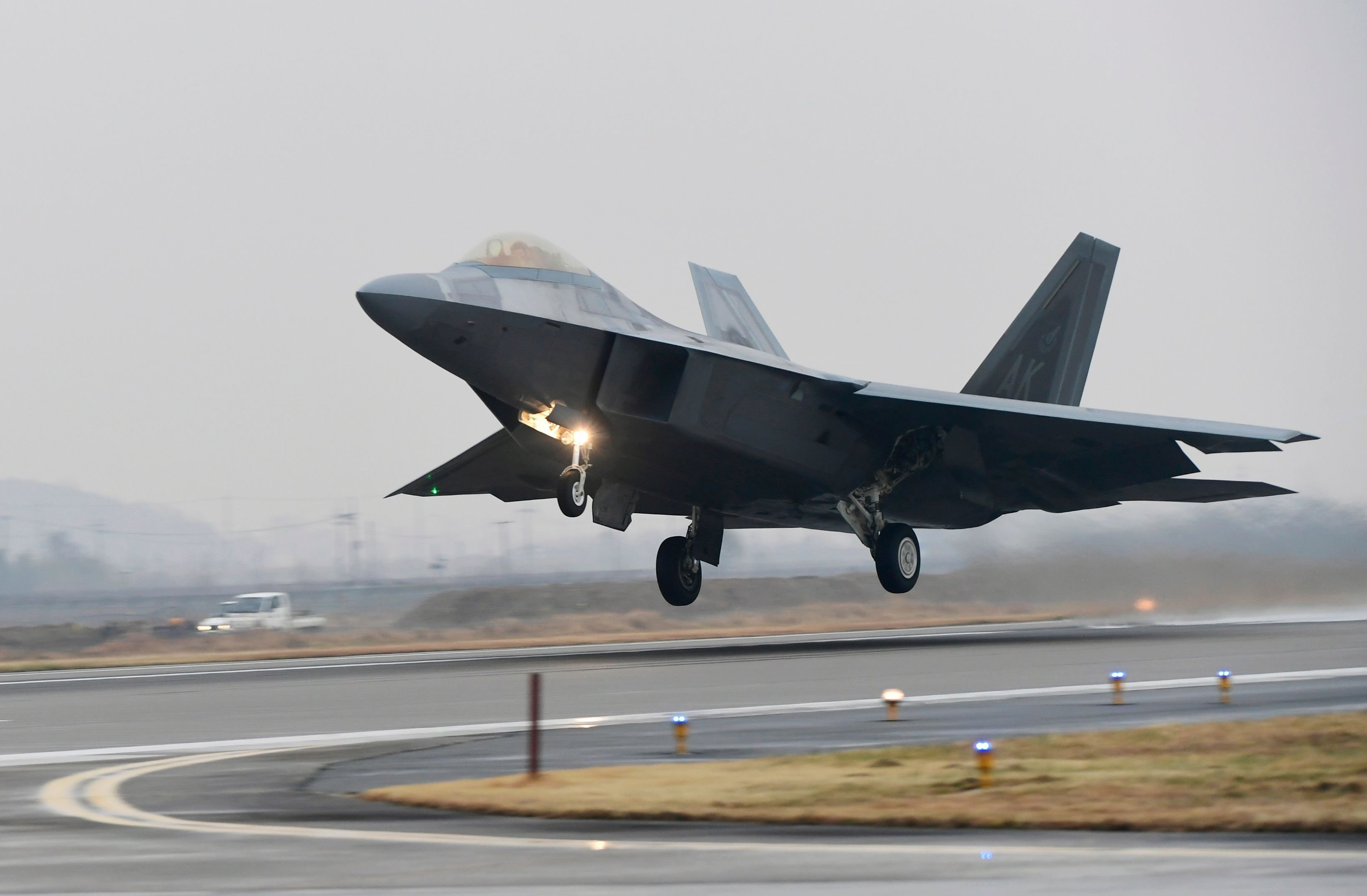 **This image is for use with this specific article only.**  A US Air Force F-22 Raptor stealth jet takes off at a South Korean air base in Gwangju on December 4, 2017.