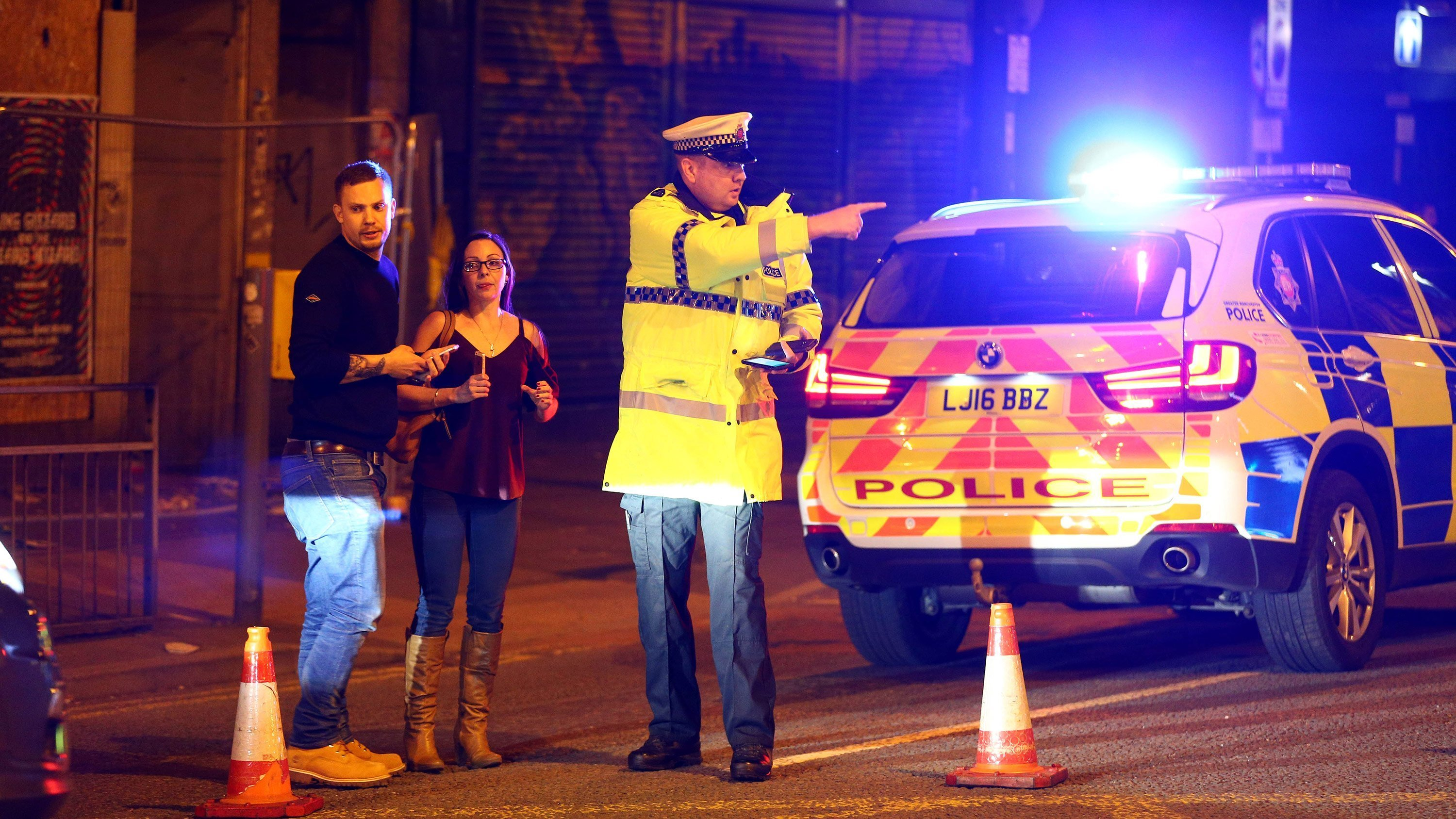 **This image is for use with this specific article only.**  Police stand near a cordoned-off street close to the Manchester Arena on May 22.