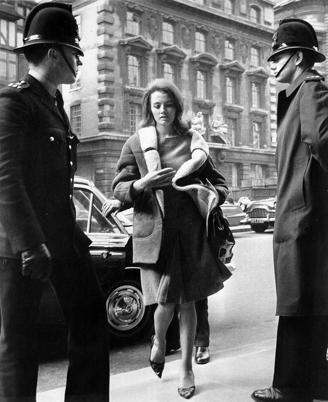 **This image is for use with this specific article only.**  In this file photo dated April 1, 1963, Christine Keeler, 21, arrives at the Old Bailey in London, where her bail was forfeited for her failure to appear earlier as a court witness in a...