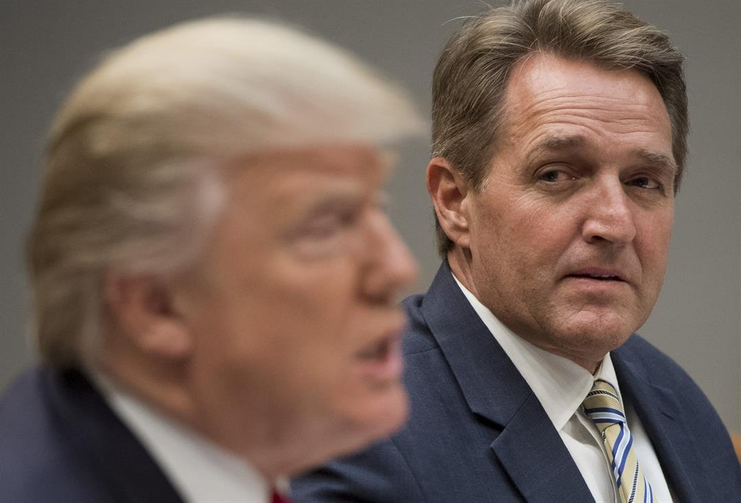 **This image is for use with this specific article only**  President Donald Trump speaks during a White House lunch meeting with Republican members of the Senate, including Sen. Jeff Flake, right.