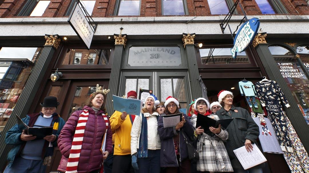 **This image is for use with this specific article only**  Members of the Portland Community Chorus sing holiday carols in downtown Portland, Maine.
