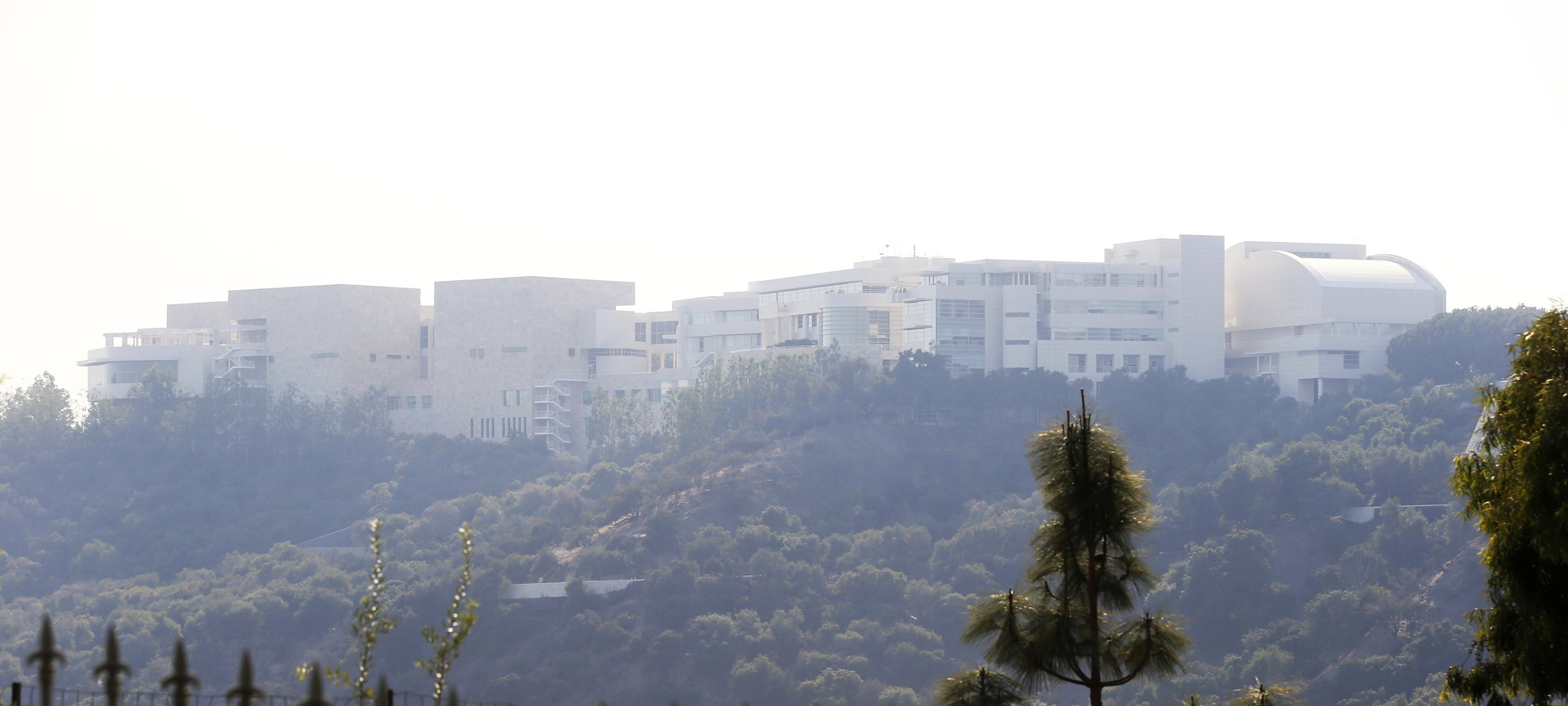 **This image is for use with this specific article only.**  The Getty Center lies shrouded in smoke as seen from the Bel-Air district of Los Angeles after the Skirball Fire swept through on Wednesday, December 6, 2017.