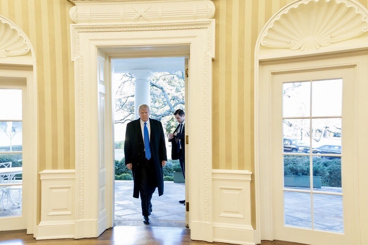 President Trump walks into The White House.