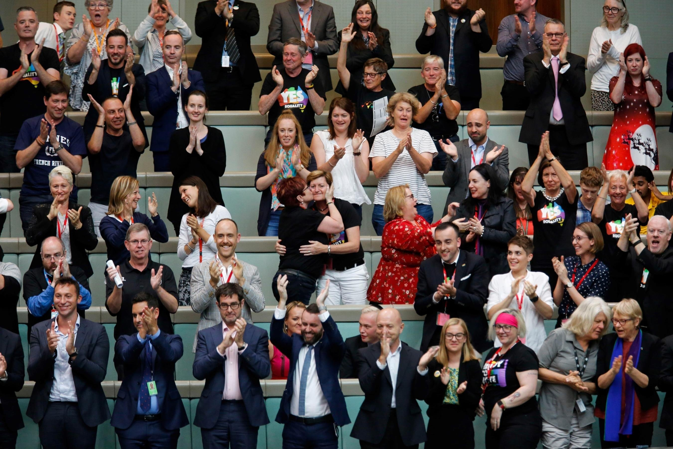 **This image is for use with this specific article only.**  Members of the public, including Christine Forster and partner Virginia Edwards, react from the gallery in Parliament House after legislators passed the same-sex marriage bill on Thursday,...