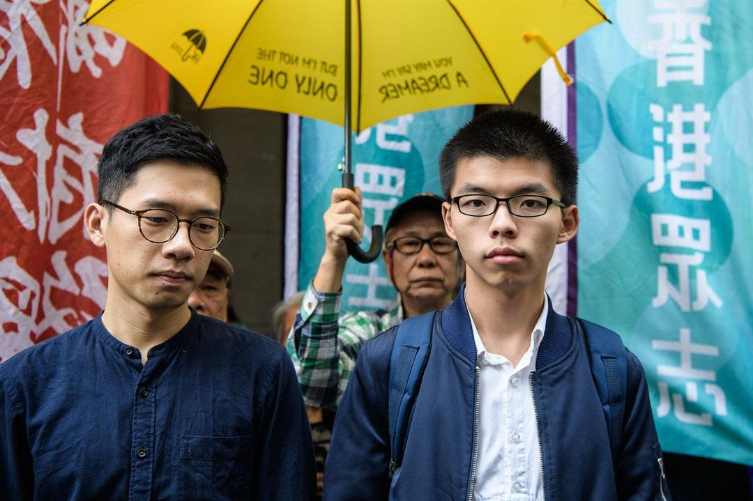 **This image is for use with this specific article only.**  Hong Kong activists Nathan Law and Joshua Wong. There has been a massive uptick in prosecutions of protesters in the past year.