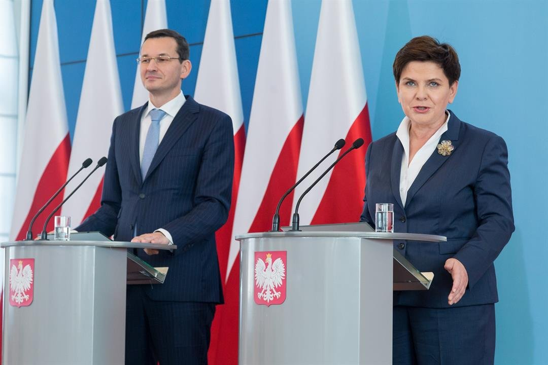 **This image is for use with this specific article only.**  Credit: Mateusz Wlodarczyk/NurPhoto/Getty Images  Prime Minister Beata Szydlo, right, is being replaced by Finance Minister Mateusz Morawiecki, left.