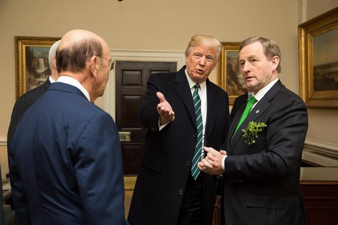 President Donald Trump introduces Enda Kenny the Taoiseach of Ireland to Wilbur Ross U.S. Secretary of Commerce in the West Wing Lobby on Thursday