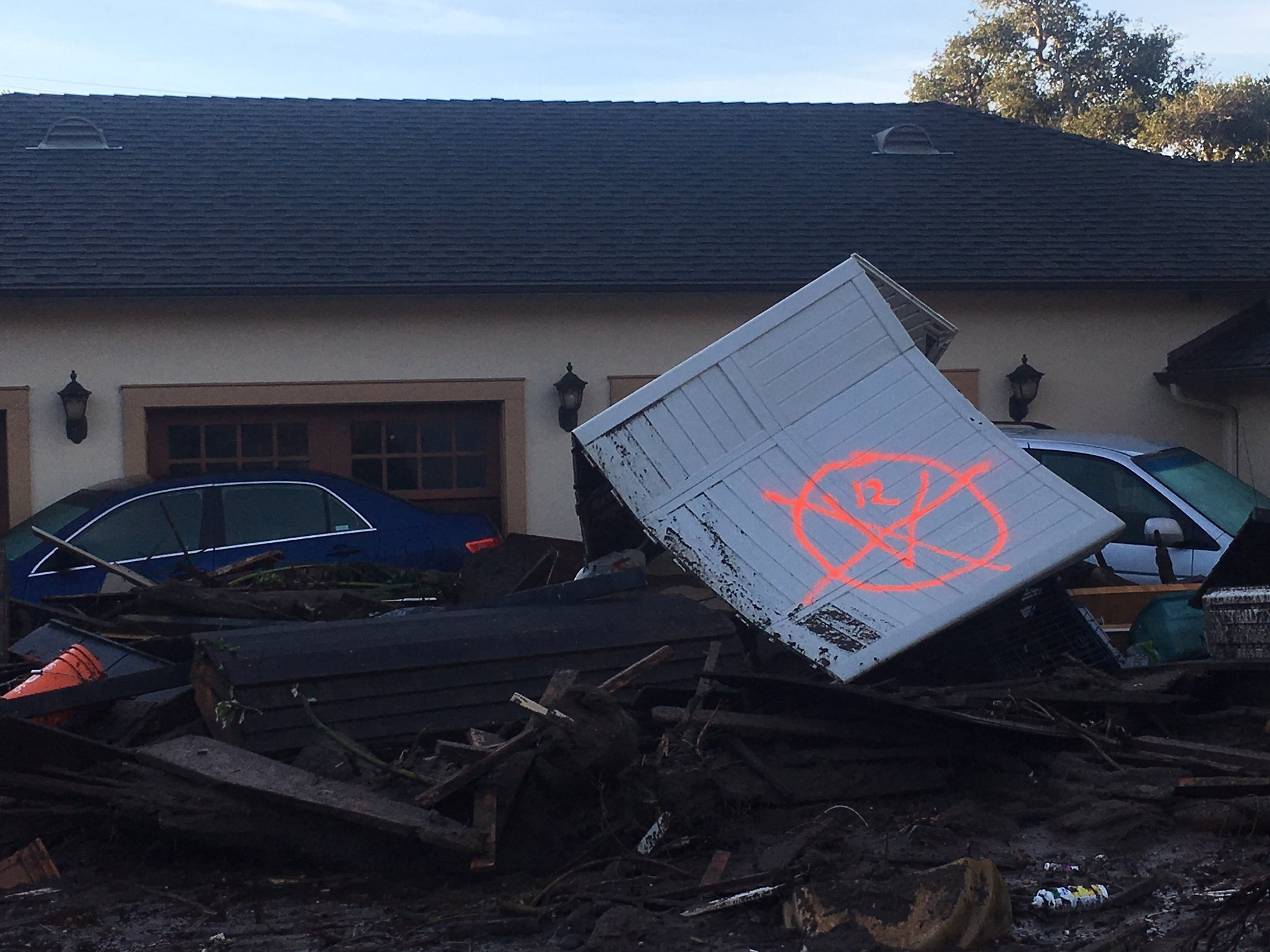 A home in Montecito, California is ruined the mudslides. The home is covered in debris and had a gas blowout. The front windows of the property are completely gone.
