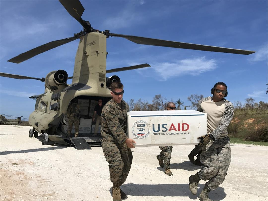 US troops unload plastic tarps with aid outside the town of Jeremie, Haiti,  in the aftermath of Hurricane Matthew in 2016.