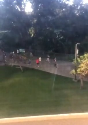 Students at the University of Hawaii at Manoa running after false alert issued.