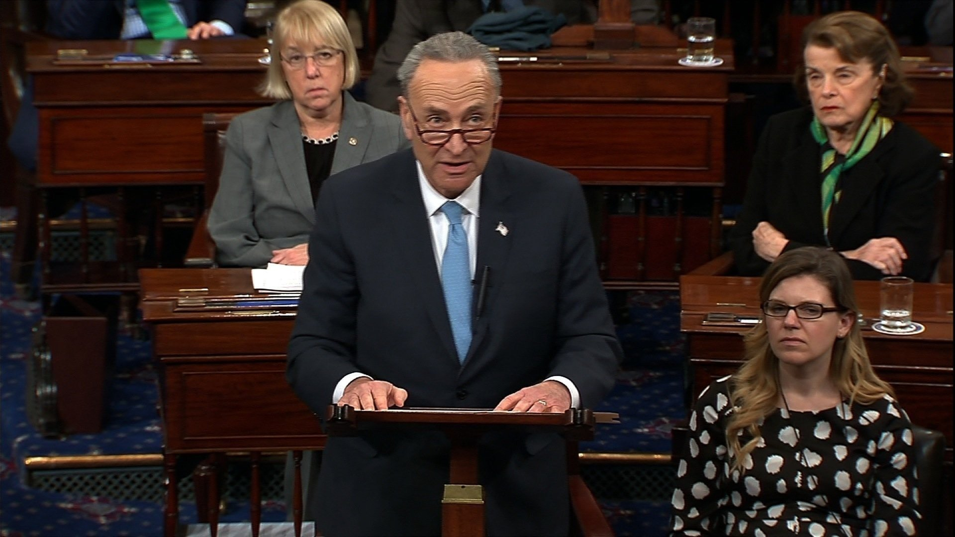 Senators continued to scramble to reach a deal to fund the government. Senator Chuck Schumer is seen here speaking on the night of the shutdown